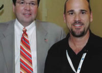 Burk poses with Neil Cavuto from the Fox News Channel and Fox Business Network 2005