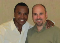 Burk poses with boxing champion, Sugar Ray Leonard at NPC's Masters Conference July 2011