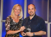 Burk receives award for being the #5 rep in the nation at NPC, with Pres. and CEO of NPC, Lynn Niedermeier April 2011