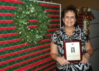 Cindy Pennington is honored for her 10 years of service with Rosenthal Retirement Planning December 2010