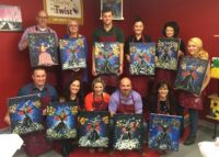 The Rosenthal Family gives Becki a going away celebration at Painting with a Twist.