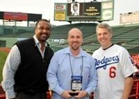 Burk receives his award from Hall of Famer Jim Rice for being a Top Ten Registered Representative with NPC August 2010