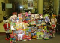 Rosenthal clients donated more toys than ever this year to Toys for Tots, overflowing three large boxes December 2011